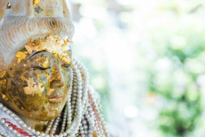 ancient guanyin statue with pearl necklace